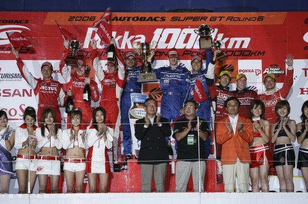 2006 Japanese Super GT ChampionshipSuzuka 1000km, Japan. 20th August 2006GT500 podium - winners Benoit Treluyer / Kazuki Hoshino / Jeremie Dufour (CALSONIC IMPUL Z) 1st position. Michael Krumm / Richard Lyons / Fabio Carbone (MOTUL AUTECH Z) 2nd position. Naoki Hattori / Peter Dumbreck / Eiichi Tajima (BANDAI DIREZZA SC430) 3rd position.Photo: Yasushi Ishihara / LAT Photographicref: Digital Image 2006SGT_R6_008