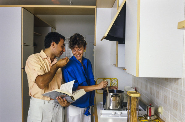 Michele Alboreto, Ferrari, and wife Nadia in the kitchen of their home in Monaco