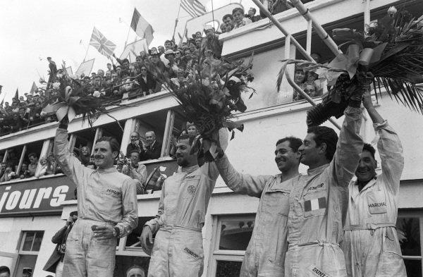 Jean Guichet / Nino Vaccarella, Scuderia Ferrari, Ferrari 275P, 1st position, and Jo Bonnier / Graham Hill, Maranello Concessionaires, Ferrari 330P, 2nd position, on the podium.
