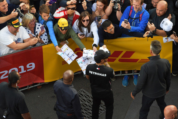 Lewis Hamilton, Mercedes AMG F1, signs autographs for fans at the Federation Square event