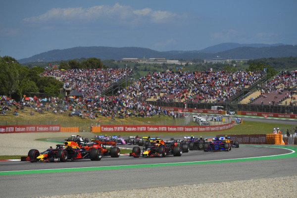 Max Verstappen, Red Bull Racing RB15, leads Charles Leclerc, Ferrari SF90, Pierre Gasly, Red Bull Racing RB15, and the remainder of the field at the start