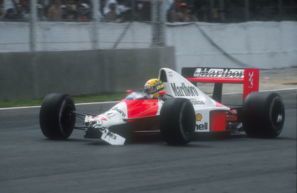 1990 Brazilian Grand Prix.Interlagos, Sao Paulo, Brazil.23-25 March 1990.Ayrton Senna (McLaren MP4/5B Honda) was leading comfortably, until he collided with backmarker Nakajima and lost his front wing. He had to pit and then settle for a dissappointing 3rd position in his view.Ref-90 BRA 06.World Copyright - LAT Photographic
