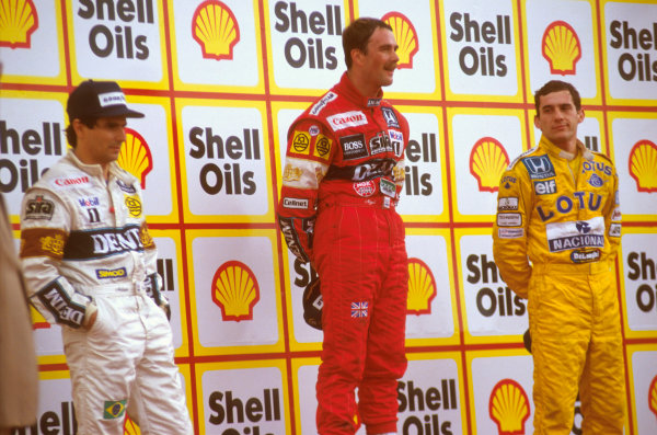 Silverstone, England.10-12 July 1987.Nigel Mansell (Williams Honda) 1st position, Nelson Piquet (Williams Honda) and Ayrton Senna (Team Lotus) 3rd position on the podium.Ref-87 GB 14.World Copyright - LAT Photographic