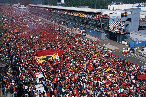 Ferrari fans invade the circuit after the race.