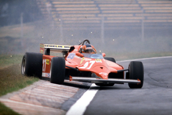 Gilles Villeneuve, Ferrari 126CK, corrects a slide as he runs wide onto the grass.