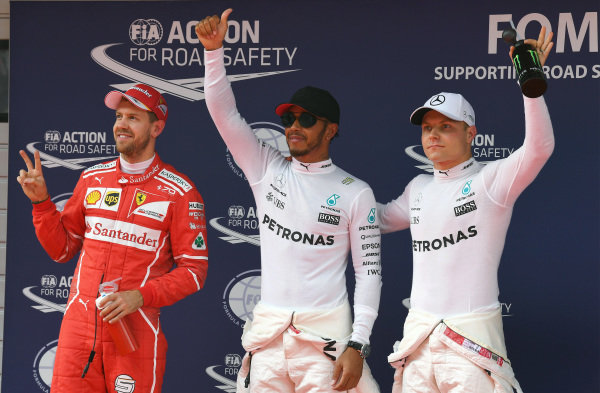 Sebastian Vettel (GER) Ferrari, pole sitter Lewis Hamilton (GBR) Mercedes AMG F1 and Valtteri Bottas (FIN) Mercedes AMG F1 celebrate in parc ferme at Formula One World Championship, Rd2, Chinese Grand Prix, Qualifying, Shanghai, China, Saturday 8 April 2017.