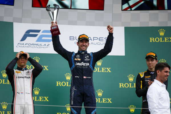 HUNGARORING, HUNGARY - AUGUST 03: Race winner Nicholas Latifi (CAN, DAMS) celebrates on the podium with the trophy and Nyck De Vries (NLD, ART GRAND PRIX) and Jack Aitken (GBR, CAMPOS RACING) during the Hungaroring at Hungaroring on August 03, 2019 in Hungaroring, Hungary. (Photo by Joe Portlock / LAT Images / FIA F2 Championship)