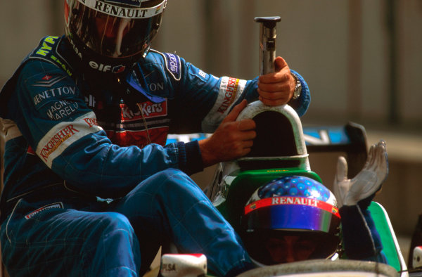 Hockenheim, German.26-28 July 1996.Gerhard Berger gets a lift back to the pits with teammate Jean Alesi (Benetton B196 Renault) after being 3 laps from victory.Ref-96 GER 12.World Copyright - LAT Photographic