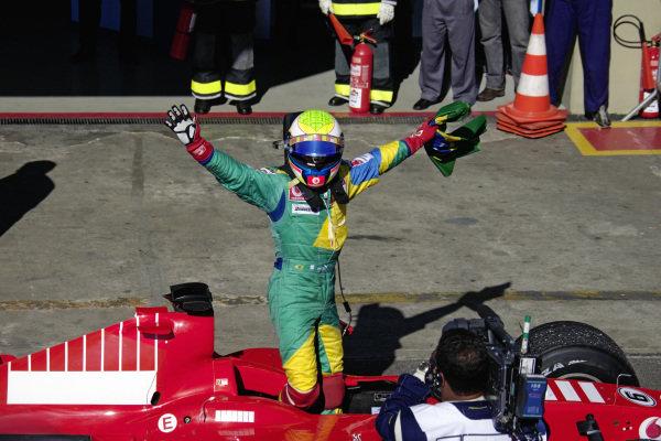 Felipe Massa celebrates his first home win in parc fermé.