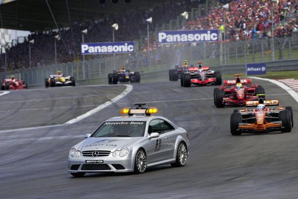 The Safety Car leads the field around the track with Markus Winkelhock, Spyker F8-VII Ferrari ahead of Felipe Massa, Ferrari F2007 and Fernando Alonso, McLaren MP4-22 Mercedes.