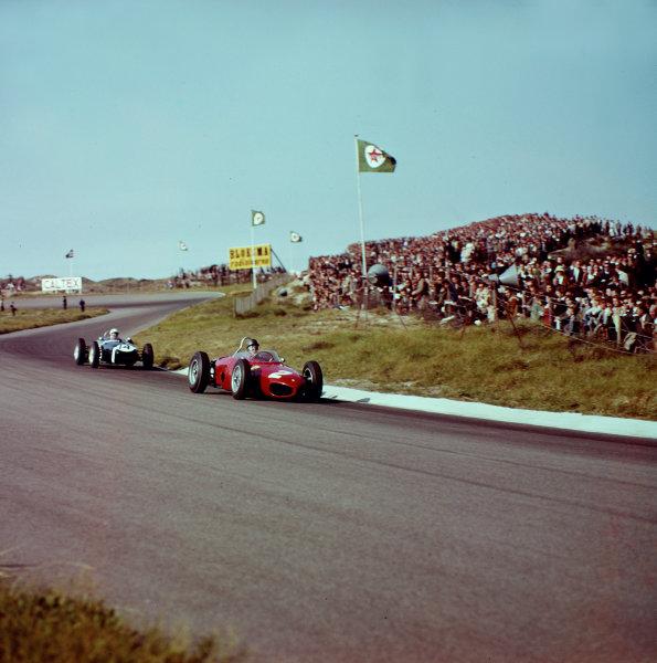 1961 Dutch Grand Prix.Zandvoort, Holland.20-22 May 1961.Richie Ginther (Ferrari Dino 156) leads Stirling Moss (Lotus 18 Climax).Ref-3/0282.World Copyright - LAT Photographic