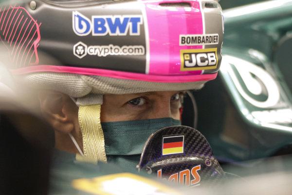 Sebastian Vettel, Aston Martin, puts his helmet on