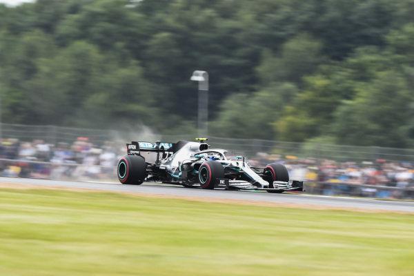 Valtteri Bottas, Mercedes AMG W10, celebrates after securing pole position