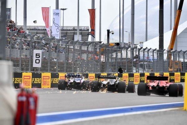 Lance Stroll, Racing Point RP19, Romain Grosjean, Haas VF-19, and Sebastian Vettel, Ferrari SF90