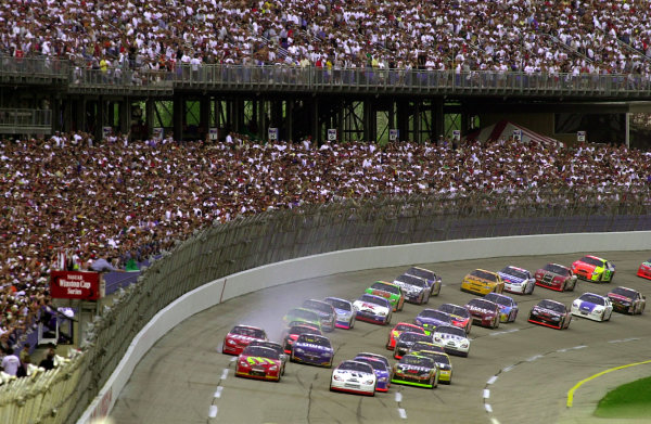 Bill Elliott (front,left) and pole sitter Jeremy Mayfield lead the field to the start as Dale Earnhardt,Jr. steps out of line (red car,far left) after locking his right front brake when avoiding rearending his father.NASCAR DieHard 500 at Talladega Superspeedway 16 April,2000 LAT PHOTOGRAPHIC-F Peirce Williams 2000
