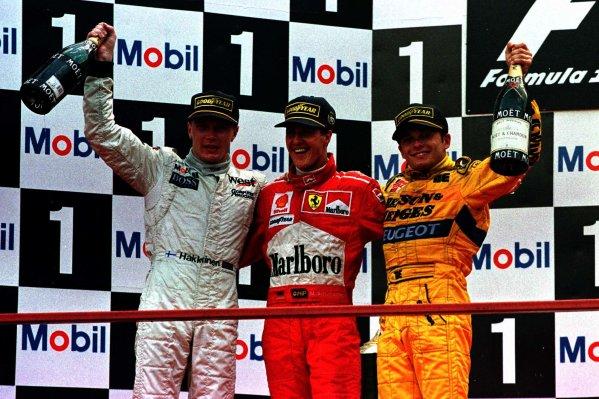 1997 Belgian Grand Prix.Spa-Francorchamps, Belgium.22-24 August 1997.Michael Schumacher (Ferrari), Giancarlo Fisichella (Jordan Peugeot) and Mika Hakkinen (McLaren Mercedes-Benz) after finishing in 1st, 2nd and 3rd positions respectively.World Copyright - Coates/LAT Photographic