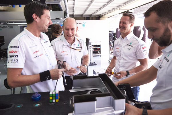 l Thursday 22nd November 2012. Michael Schumacher, Mercedes AMG, jokes with his mechanics. World Copyright: Steve Etherington/c ref: Digital Image SNE28882 copy