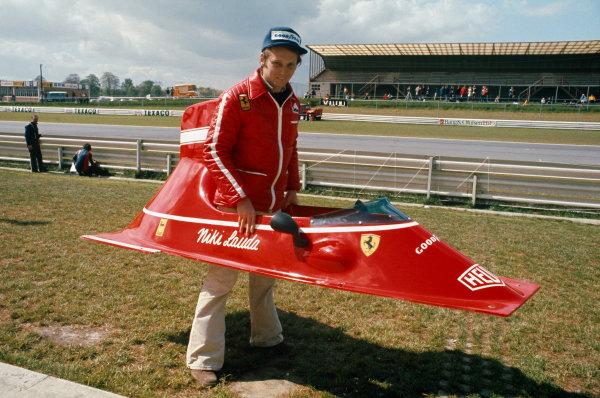 Nivelles-Baulers, Belgium. 12 May 1974. Niki Lauda playing with bodywork from his Ferrari 312B3. Portrait. World Copyright: LAT Photographic. Ref: 74BEL01