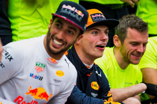 Sepang International Circuit, Sepang, Malaysia. Sunday 1 October 2017. Daniel Ricciardo, Red Bull Racing, 3rd Position, Max Verstappen, Red Bull, 1st Position, and the Red Bull Racing team celebrate. World Copyright: Glenn Dunbar/LAT Images  ref: Digital Image _X0W9220
