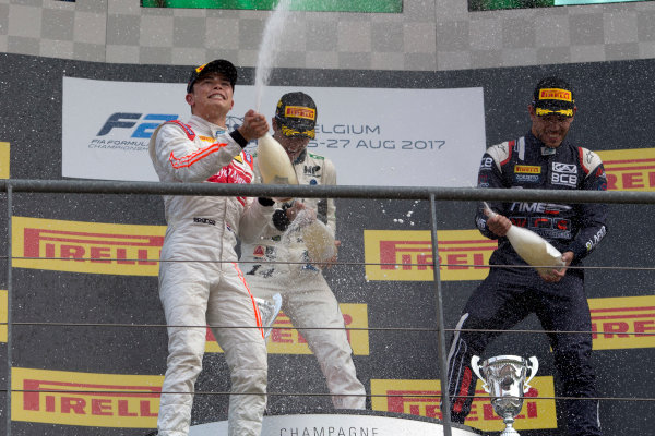 2017 FIA Formula 2 Round 8. Spa-Francorchamps, Spa, Belgium. Sunday 27 August 2017. Sergio Sette Camara (BRA, MP Motorsport) celebrates his victory on the podium with Nyck De Vries (NED, Racing Engineering) and Luca Ghiotto (ITA, RUSSIAN TIME).  Photo: Alastair Staley/FIA Formula 2. ref: Digital Image _L5R6082