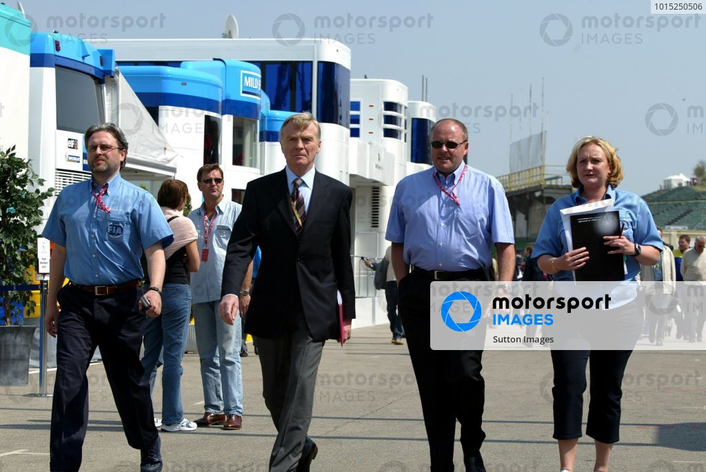 (L to R): An FIA official, Max Mosley (GBR) FIA President, another official and Agnes Kaiser (FRA) FIA. Formula One World Championship, Rd4, San Marino Grand Prix, Preparations, Imola, Italy, 17 April 2003.DIGITAL IMAGE