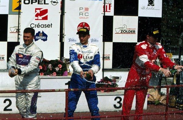 The top three drivers celebrate on the podium.Belgian Procar Championship, Rd1, Zolder, Belgium. 21 April 2002.BEST IMAGE