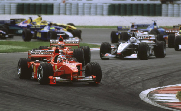 Sepang, Kuala Lumpur, Malaysia. 15-17 October 1999.Michael Schumacher (Ferrari F399) leads at athe start of the race. He finished in 2nd position.Ref-99 MAL 14.World Copyright - LAT Photographic
