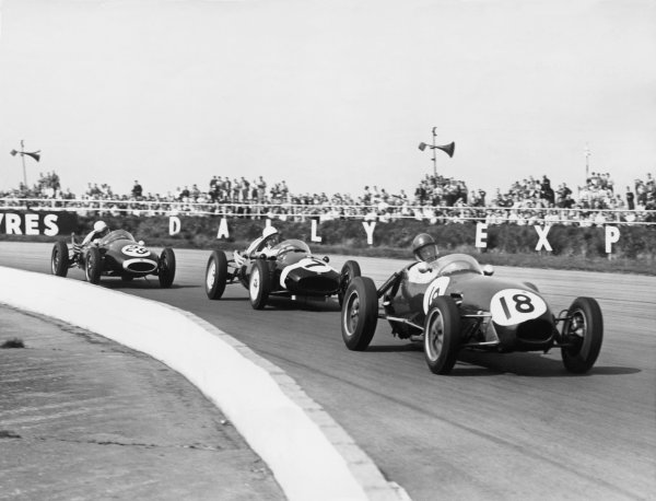 Silverstone, Great Britain. 3rd May 1958Cliff Allison (Lotus 12-Climax), 6th position, leads Stirling Moss (Cooper T43-Climax, retired, and Bruce McLaren (Cooper T45-Climax), 9th position, action. World Copyright: LAT Photographic.Ref:  B/W Print.