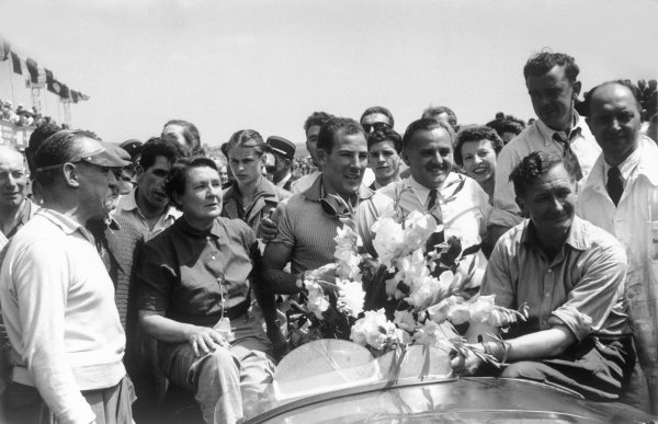 Reims, France. 4th - 5th July 1953.Stirling Moss/Peter Whitehead (Jaguar C-Type), 1st position, with his Mother and Father after winning the race, portrait.World Copyright: LAT Photographic.Ref: 53 - 66 - 33A-34.