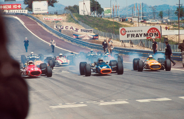 1968 Spanish Grand Prix. Jarama, Madrid, Spain. 10-12 May 1968. Poleman Chris Amon (Ferrari 312) is left behind by Pedro Rodriguez (BRM P133) and Denny Hulme (McLaren M7A Ford) at the start, action.  World Copyright: LAT Photographic Ref: 68ESP02.