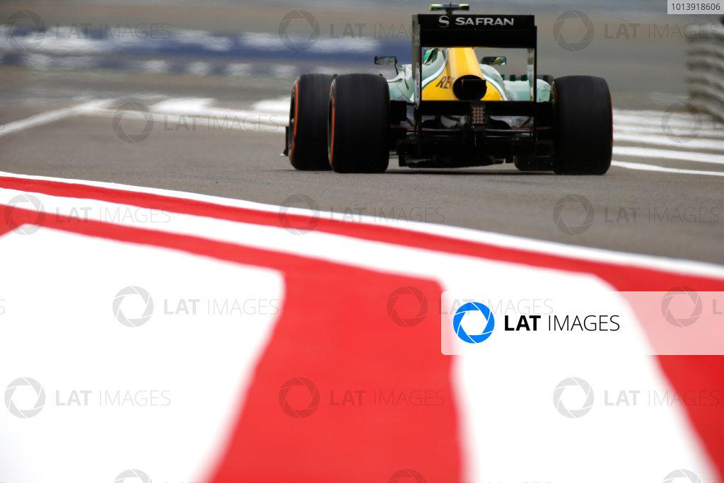 Bahrain International Circuit, Sakhir, Bahrain Friday 19th April 2013 Heikki Kovalainen, Caterham CT03 Renault.  World Copyright: Glenn Dunbar/LAT Photographic ref: Digital Image _89P0048