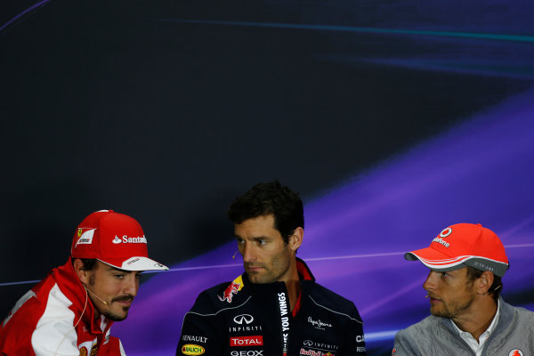 Silverstone, Northamptonshire, England 27th June 2013 Fernando Alonso, Ferrari, Mark Webber, Red Bull Racing and Jenson Button, McLaren talk in the press conference World Copyright: Charles Coates/  ref: Digital Image _N7T6215