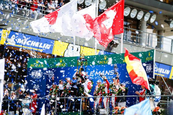 #3 Rebellion Racing Rebellion R-13: Mathias Beche, Gustavo Menezes, Thomas Laurent, finishes 3rd,  #7 Toyota Gazoo Racing Toyota TS050: Mike Conway, Kamui Kobayashi, Jose Maria Lopez, finishes and Fernando Alonso, Toyota Gazoo Racing, and Sébastien Buemi, Toyota Gazoo Racing, celebrate win Le Mans 2018