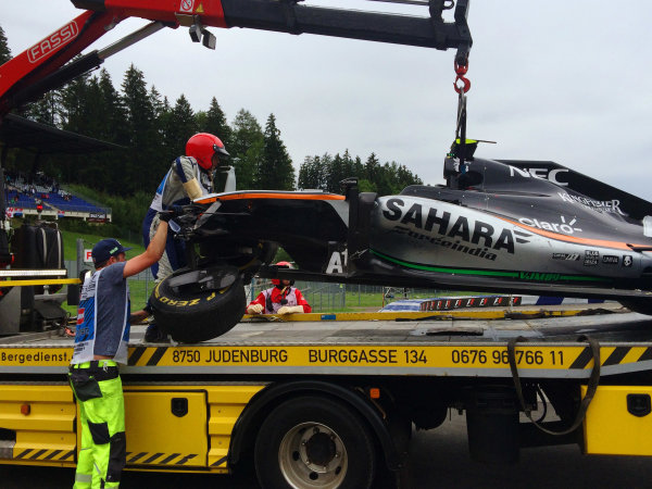 Red Bull Ring, Spielberg, Austria. Sunday 3 July 2016. Marshals remove the damaged car of Sergio Perez, Force India VJM09 Mercedes, after his last lap crash. World Copyright: Anthony Rowlinson/LAT Photographic ref: Digital Image IMG_3171