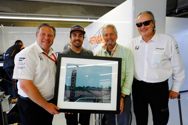 Circuit Gilles Villeneuve, Montreal, Canada. Saturday 10 June 2017. Actor Michael Douglas is presented with a photo of Fernando Alonso, McLaren, leading the Indy 500 by Fernando Alonso, Mansour Ojjeh, CEO, TAG, and Zak Brown, Executive Director, McLaren Technology Group. World Copyright: Steven Tee/LAT Images ref: Digital Image _R3I2334