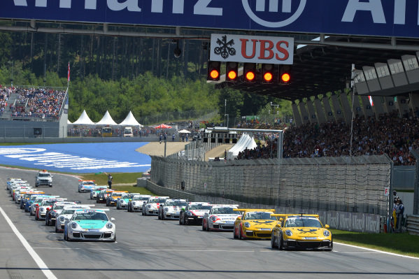 Philipp Eng (AUT) leads the start of the race. Porsche Supercup, Rd3, Spielberg, Austria, Sunday 21-22 June 2014.