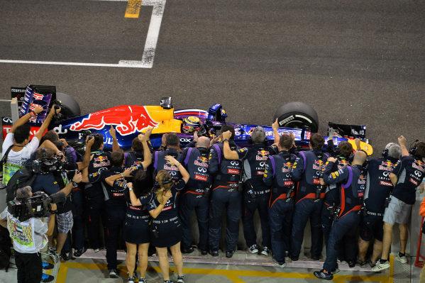 Race winner Sebastian Vettel (GER) Red Bull Racing RB9 crosses the line. Formula One World Championship, Rd17, Abu Dhabi Grand Prix, Race Day, Yas Marina Circuit, Abu Dhabi, UAE, Sunday 3 November 2013. BEST IMAGE