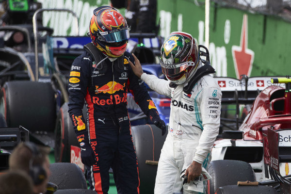 Lewis Hamilton, Mercedes AMG F1, and Alexander Albon, Red Bull Racing, talk in Parc Ferme