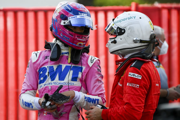 Lance Stroll, Racing Point, and Sebastian Vettel, Ferrari, talk in Parc Ferme after the race