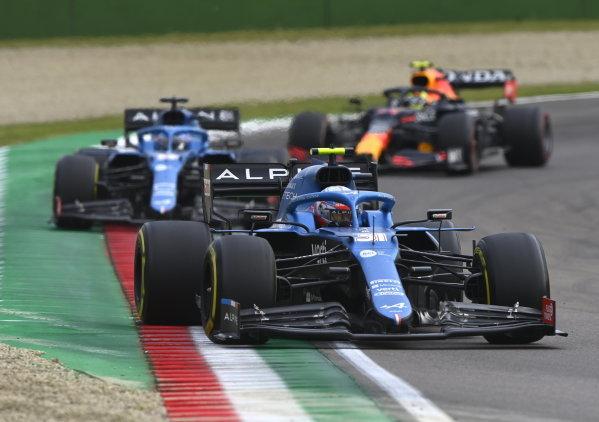Esteban Ocon, Alpine A521, leads Fernando Alonso, Alpine A521, and Sergio Perez, Red Bull Racing RB16B