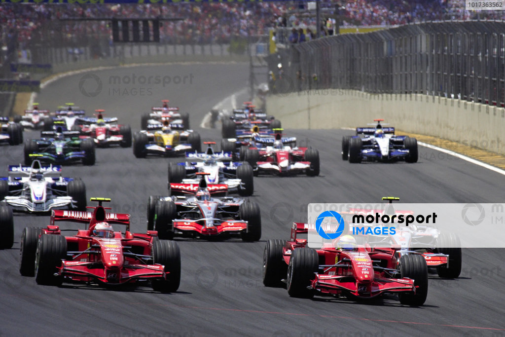 Felipe Massa, Ferrari F2007 leads Kimi Räikkönen, Ferrari F2007 and Lewis Hamilton, McLaren MP4-22 Mercedes at the start.