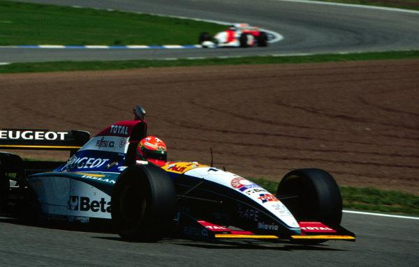 1995 Spanish Grand Prix.Catalunya, Barcelona, Spain.12-14 May 1995.Eddie Irvine (Jordan 195 Peugeot) 5th position.World Copyright - LAT Photographic
