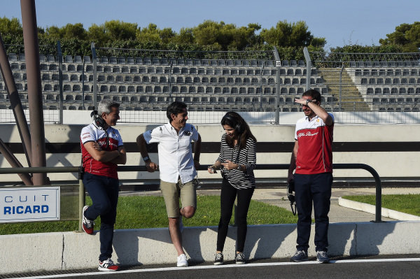 Xevi Pujolar, far left, stands next to Diego Mejia and Madam Carmen (mother of Juan Manuel Correa). Juan Manuel Correa (USA) Alfa Romeo Racing in his first Formula 1 test in a Sauber C32 fitted with Ferrari V8 atmospheric engine