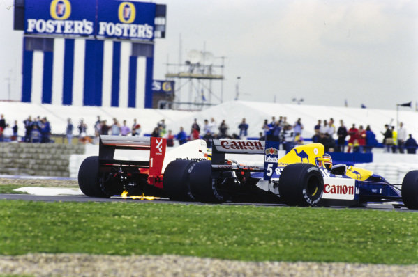 Ayrton Senna, McLaren MP4-6 Honda, battles with Nigel Mansell, Williams FW14 Renault.