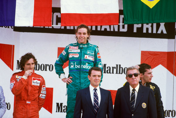 Mexico City, Mexico. 10-12 October 1986. Gerhard Berger (Benetton BMW) 1st position, Alain Prost (McLaren TAG Porsche), 2nd position, and Ayrton Senna (Lotus Renault), 3rd position, on the podium with Jean Marie Balestre. Ref: 86 MEX 30 World copyright - LAT Photographic