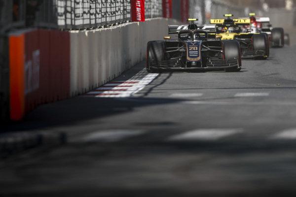 Kevin Magnussen, Haas VF-19, leads Nico Hulkenberg, Renault R.S. 19