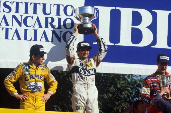 1987 Italian Grand Prix.  Monza, Italy. 4-6 September 1987.  Nelson Piquet (Williams Honda) 1st position, Ayrton Senna (Team Lotus) 2nd position and Nigel Mansell (Williams Honda) 3rd position, on the podium.  Ref: 87ITA10. World Copyright: LAT Photographic