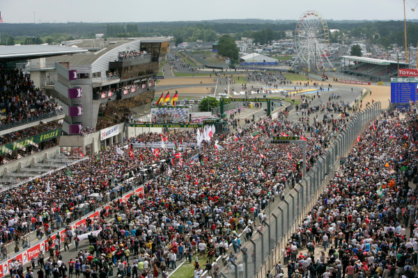 Circuit de La Sarthe, Le Mans, France. 6th - 13th June 2010.A huge crowd forms beneath the podium to celebrate a clean sweep for Audi with Mike Rockenfeller / Timo Bernhard / Romain Dumas, Audi Sport North America, No 9 Audi R15-Plus TDI, 1st position, Andre Lotterer / Marcel Fassler / Benoit Treluyer, Audi Sport Team Joest, No 8 Audi R15-Plus TDI, 2nd position, and Tom Kristensen / Dindo Capello / Allan McNish, Audi Sport Team Joest, No 7 Audi R15-Plus TDI, 3rd position. Portrait. Podium.World Copyright: Alastair Staley/LAT PhotographicDigital Image _P9O8990 jpg