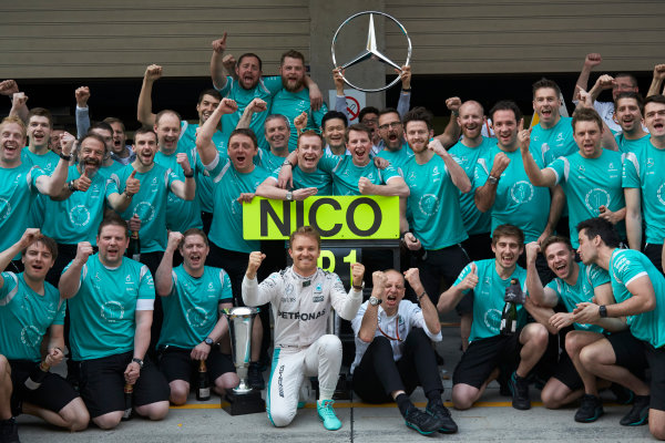 Shanghai International Circuit, Shanghai, China. Sunday 17 April 2016. Nico Rosberg, Mercedes AMG, 1st Position, Tony Ross, Race Engineer, Mercedes AMG, and the Mercedes team celebrate victory after the race. World Copyright: Steve Etherington/LAT Photographic ref: Digital Image SNE12624