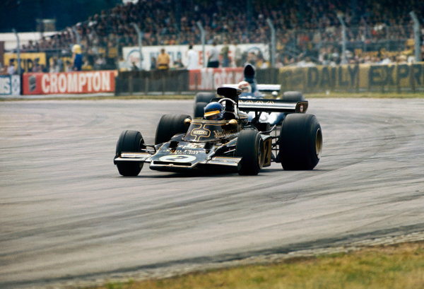 1973 British Grand Prix.  Silverstone, England. 12-14 July 1973.  Ronnie Peterson, Lotus 72E-Ford, 2nd position, leads Jackie Stewart, Tyrrell 006 Ford, 10th position.  Ref: 73GB37. World Copyright: LAT Photographic